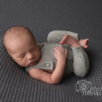 huck fin pose for newborn photo session