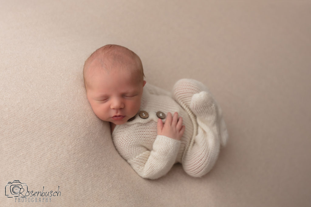 Huck fin newborn pose in studio photo session