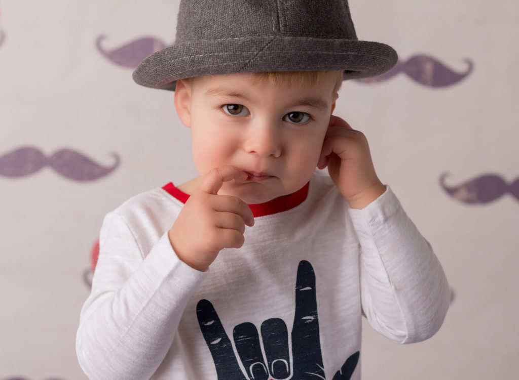 toddler in hat