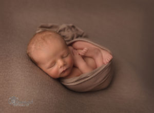 newborn baby boy womb pose