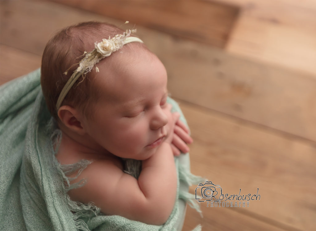 profile view of newborn girl photo session