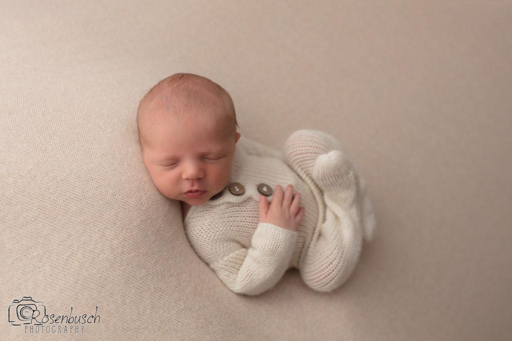 Huck fin newborn pose in studio photo session