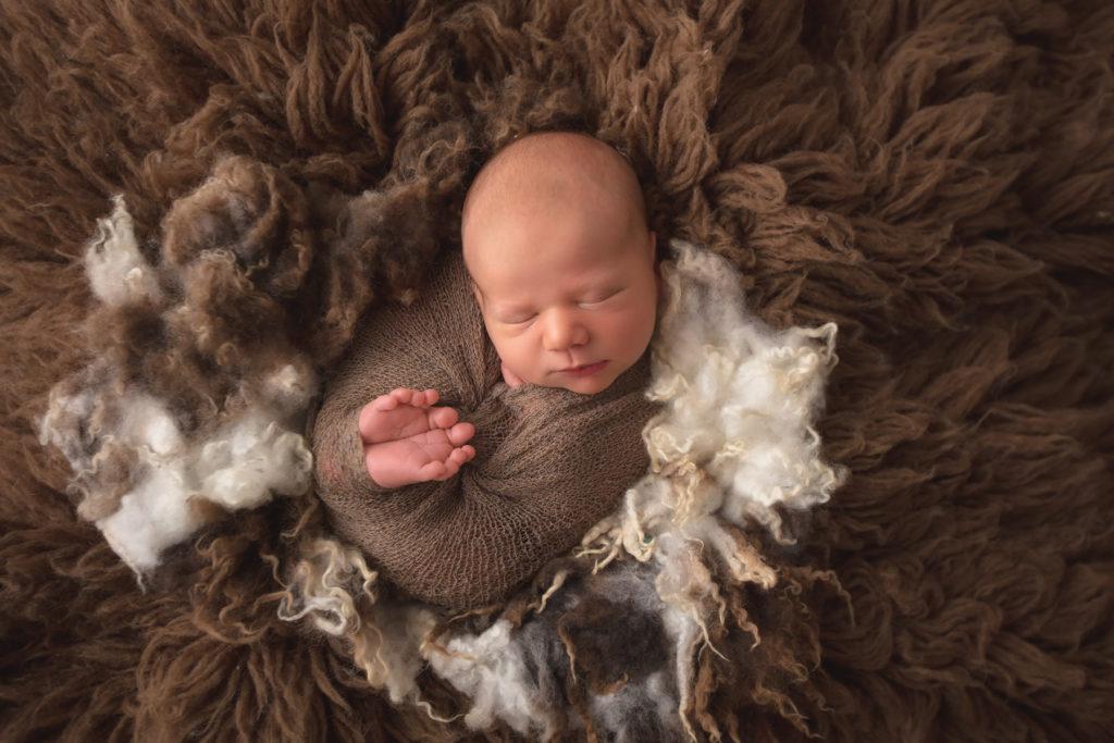 baby in flokati rug