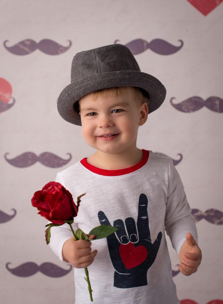 toddler boy in a fedora hat